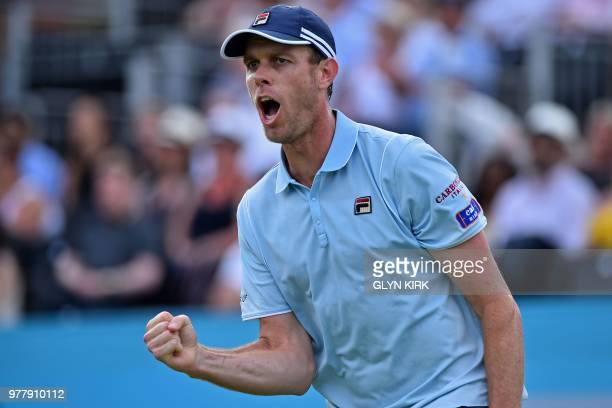 US player Sam Querrey reacts during his first round men's singles win over Britain's Jay Clarke at the ATP Queen's Club Championships tennis...