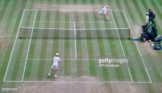 US player Sam Querrey returns against Britain's Andy Murray during their men's singles quarterfinal match on the ninth day of the 2017 Wimbledon...