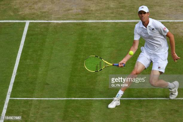 US player Sam Querrey returns against Spain's Rafael Nadal during their men's singles quarterfinal match on day nine of the 2019 Wimbledon...