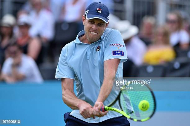US player Sam Querrey returns to Britain's Jay Clarke during their first round men's singles match at the ATP Queen's Club Championships tennis...