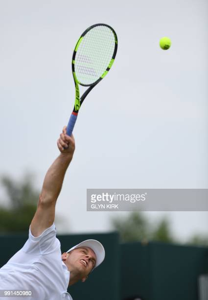 US player Sam Querrey serves to Ukraine's Sergiy Stakhovsky of Ukraine during their men's singles second round match on the third day of the 2018...