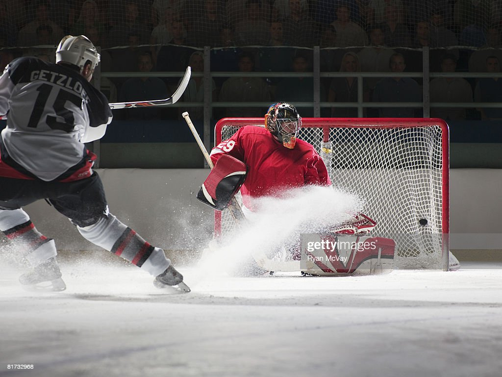 Player scoring a goal in ice hockey : Stock Photo