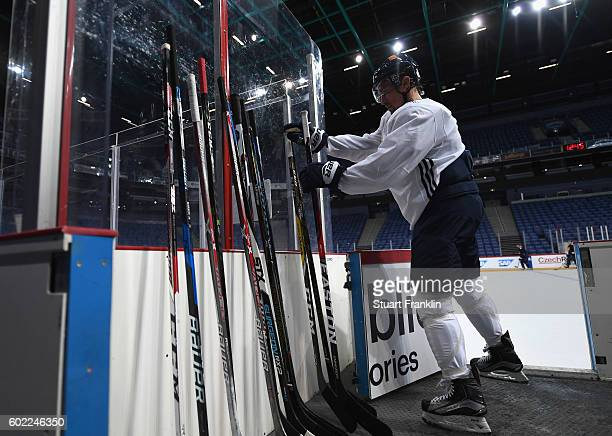 A player selects a stick during practice for Team Finland at the Hartwell Areena on September 7 2016 in Helsinki Finland