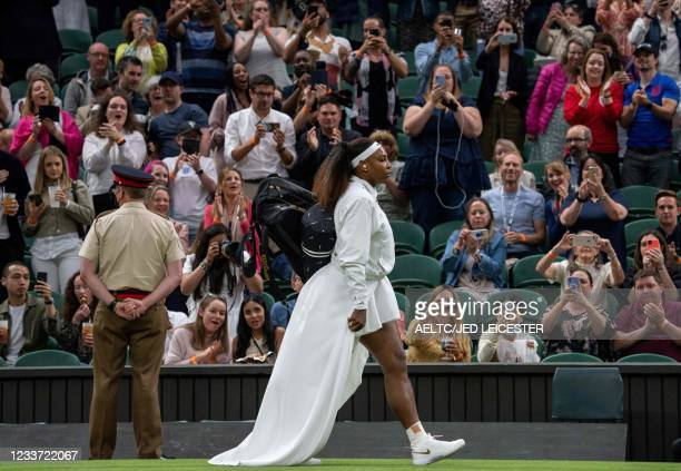Player Serena Williams arrives on court to play against Belarus's Aliaksandra Sasnovich during their women's singles first round match on the second...