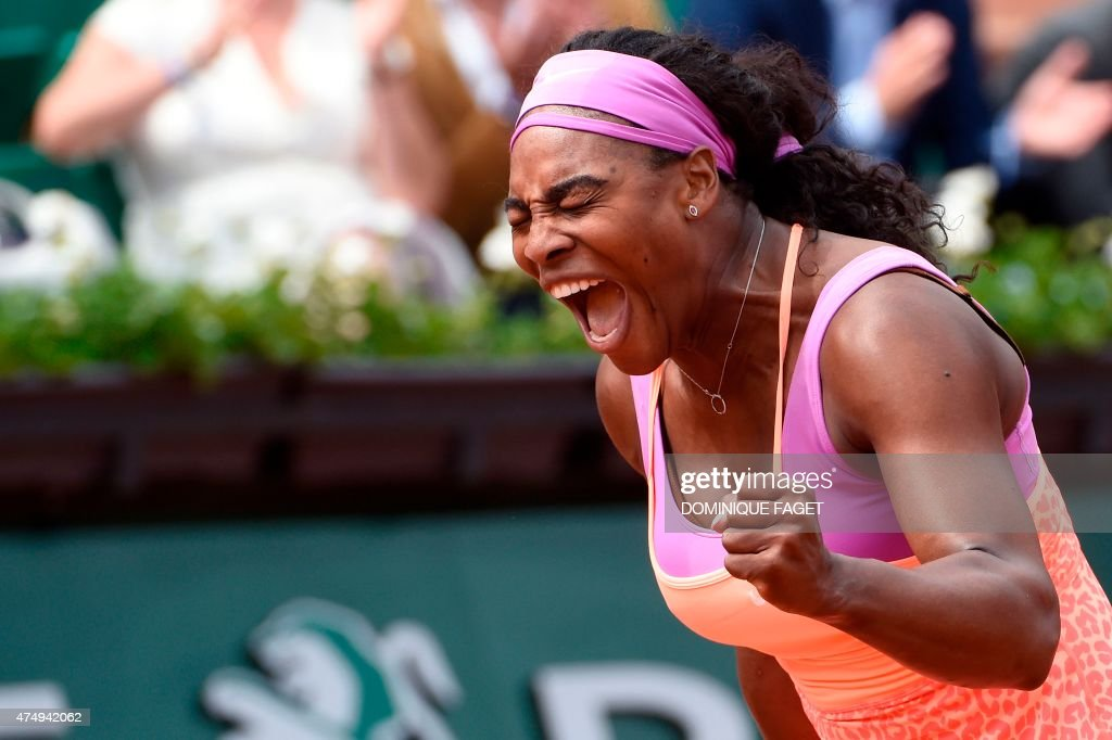 US player Serena Williams celebrates after winning her match against Germany's Anna-Lena Friedsam during the women's second round of the Roland Garros 2015 French Tennis Open in Paris on May 28, 2015. Williams won the match 5-7, 6-3, 6-3. AFP PHOTO / DOMINIQUE FAGET / AFP PHOTO / Dominique FAGET