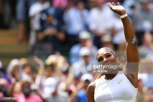 Player Serena Williams celebrates beating Spain's Carla Suarez Navarro during their women's singles fourth round match on the seventh day of the 2019...