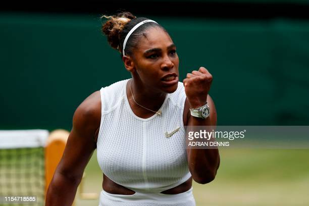 Player Serena Williams celebrates winning a point against US player Alison Riske during their women's singles quarter-final match on day eight of the...