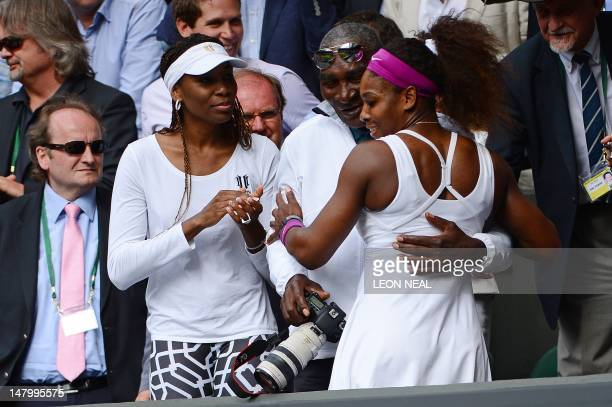 US player Serena Williams climbs up into the Royal Box to embrace her father Richard and sister Venus Williams after her women's singles final...