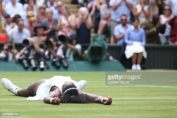 US player Serena Williams falls on the floor as she celebrates beating Germany's Angelique Kerber in the women's singles final on the thirteenth day...