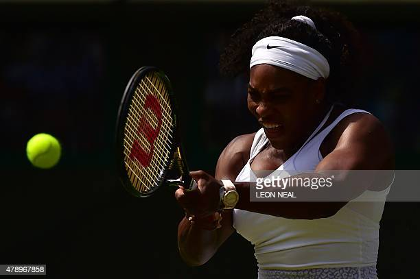 US player Serena Williams hits a return against Russia's Margarita Gasparyan during their women's singles first round match on day one of the 2015...