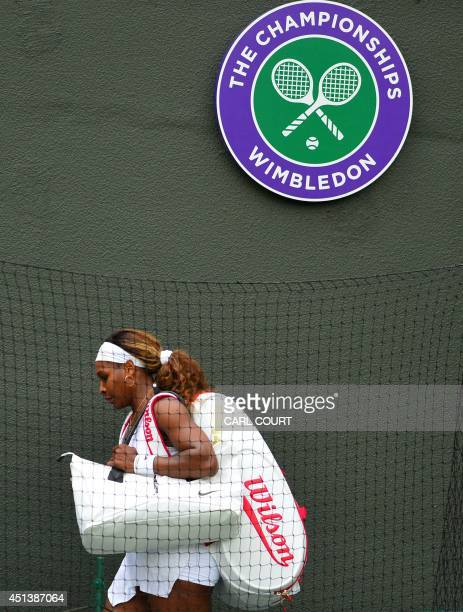 US player Serena Williams leaves the court after losing her women's singles third round match against France's Alize Cornet on day six of the 2014...