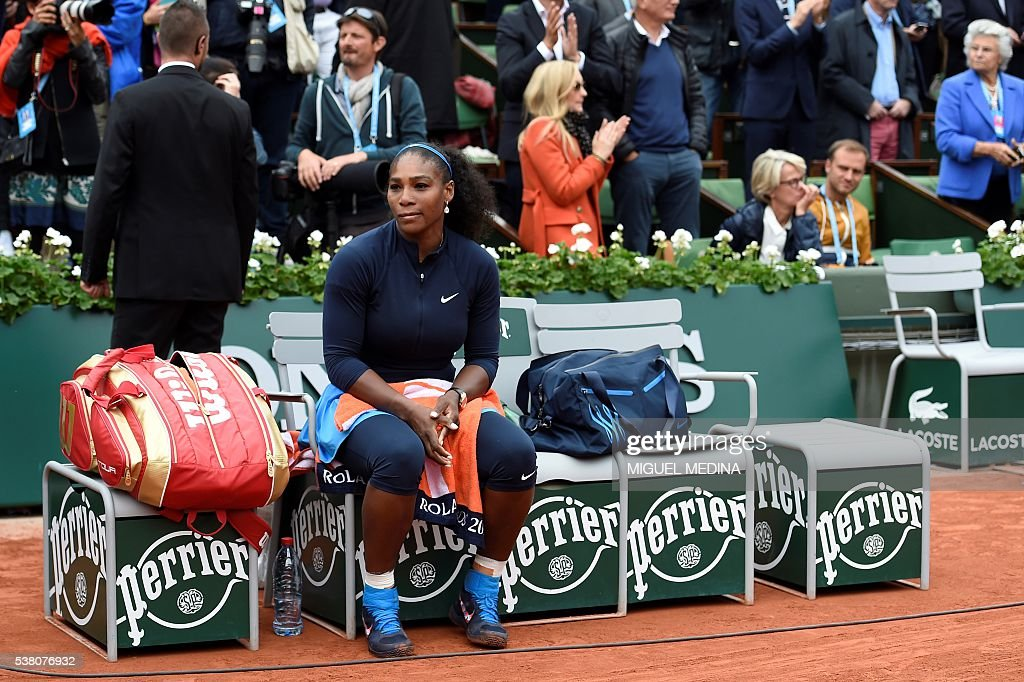 TOPSHOT - US player Serena Williams looks on after the women's final match at the Roland Garros 2016 French Tennis Open in Paris on June 4, 2016. / AFP / MIGUEL
