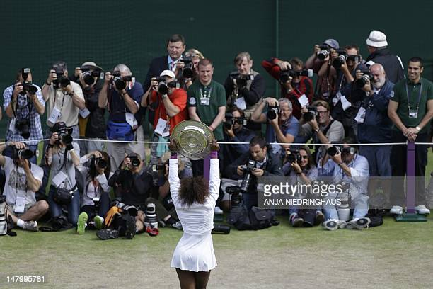 US player Serena Williams poses for photographs with the trophy the Venus Rosewater Dish after her women's singles final victory over Poland's...