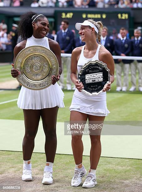 US player Serena Williams poses with the winner's trophy the Venus Rosewater Dish next to runner up Germany's Angelique Kerber after her women's...