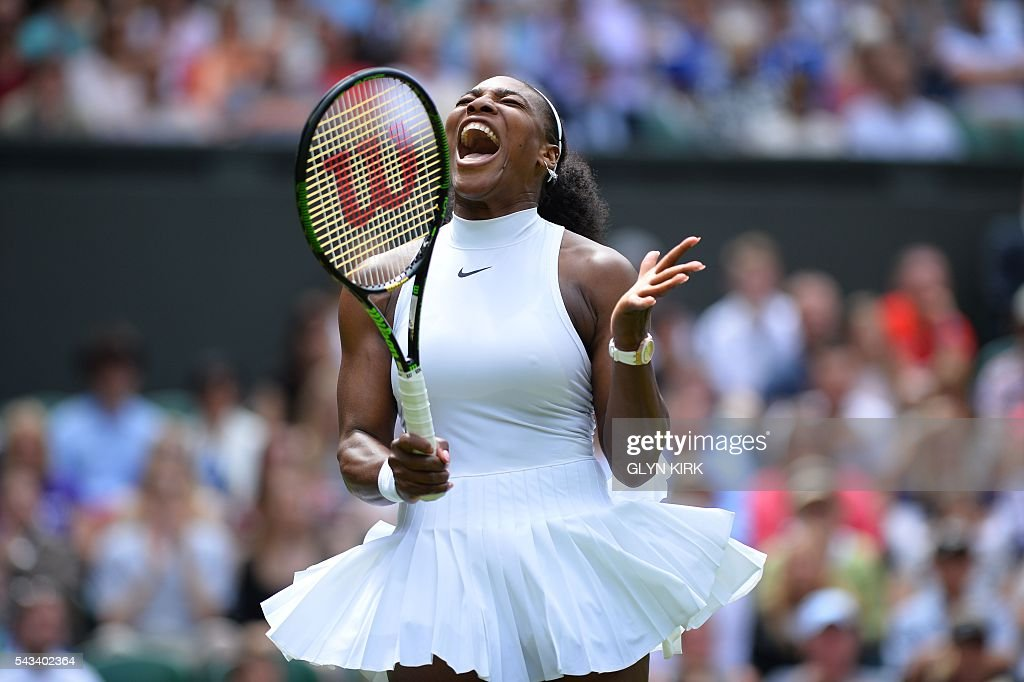 TOPSHOT - US player Serena Williams reacts after a point against Switzerland's Amra Sadikovic during their women's singles first round match on the second day of the 2016 Wimbledon Championships at The All England Lawn Tennis Club in Wimbledon, southwest London, on June 28, 2016. / AFP / GLYN