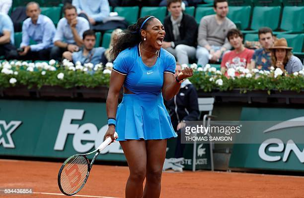 US player Serena Williams reacts after winning her women's second round match against Brazil's Teliana Pereira at the Roland Garros 2016 French...