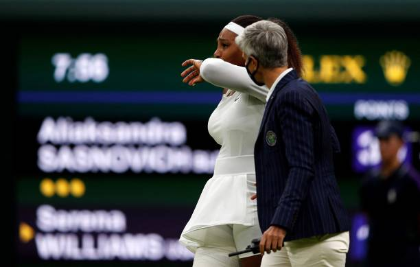 Player Serena Williams reacts as she withdraws from her women's singles first round match against Belarus's Aliaksandra Sasnovich on the second day...