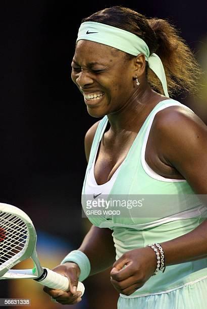 Player Serena Williams reacts during an Australian Open tennis tournament third round match against Slovakia's Daniela Hantuchova in Melbourne, 20...