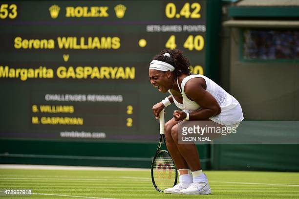 US player Serena Williams reacts to her first set come back against Russia's Margarita Gasparyan during their women's singles first round match on...