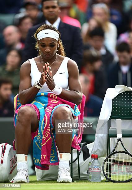US player Serena Williams rests between sets during her women's singles third round match against France's Alize Cornet on day six of the 2014...