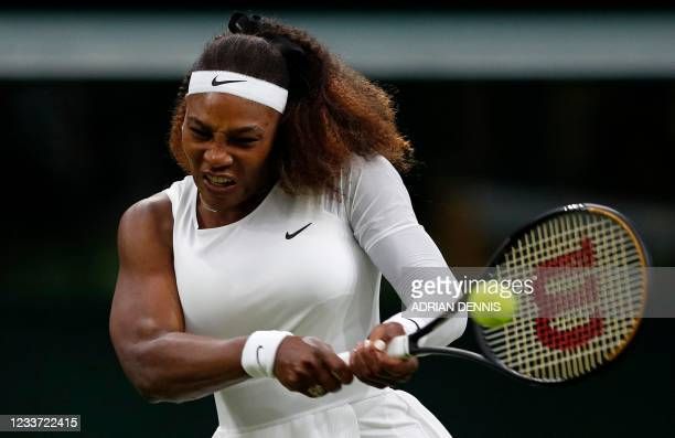 Player Serena Williams returns against Belarus's Aliaksandra Sasnovich during their women's singles first round match on the second day of the 2021...