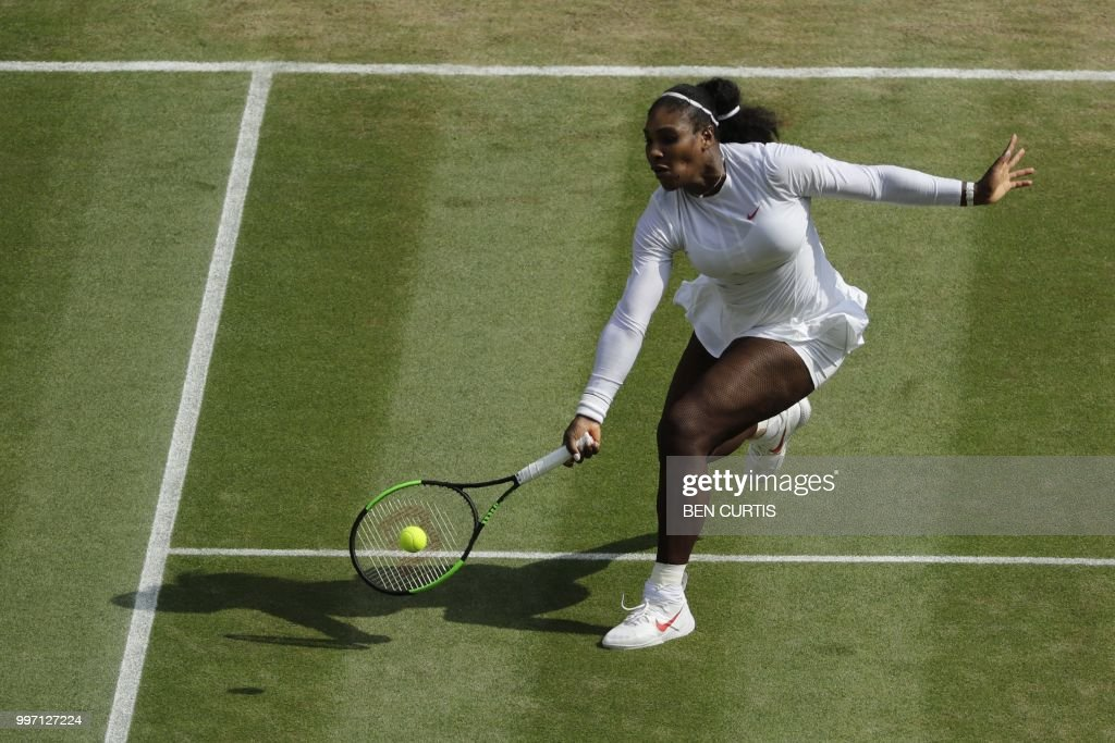 TOPSHOT - US player Serena Williams returns against Germany's Julia Goerges during their women's singles semi-final match on the tenth day of the 2018 Wimbledon Championships at The All England Lawn Tennis Club in Wimbledon, southwest London, on July 12, 2018. (Photo by Ben Curtis / POOL / AFP) / RESTRICTED