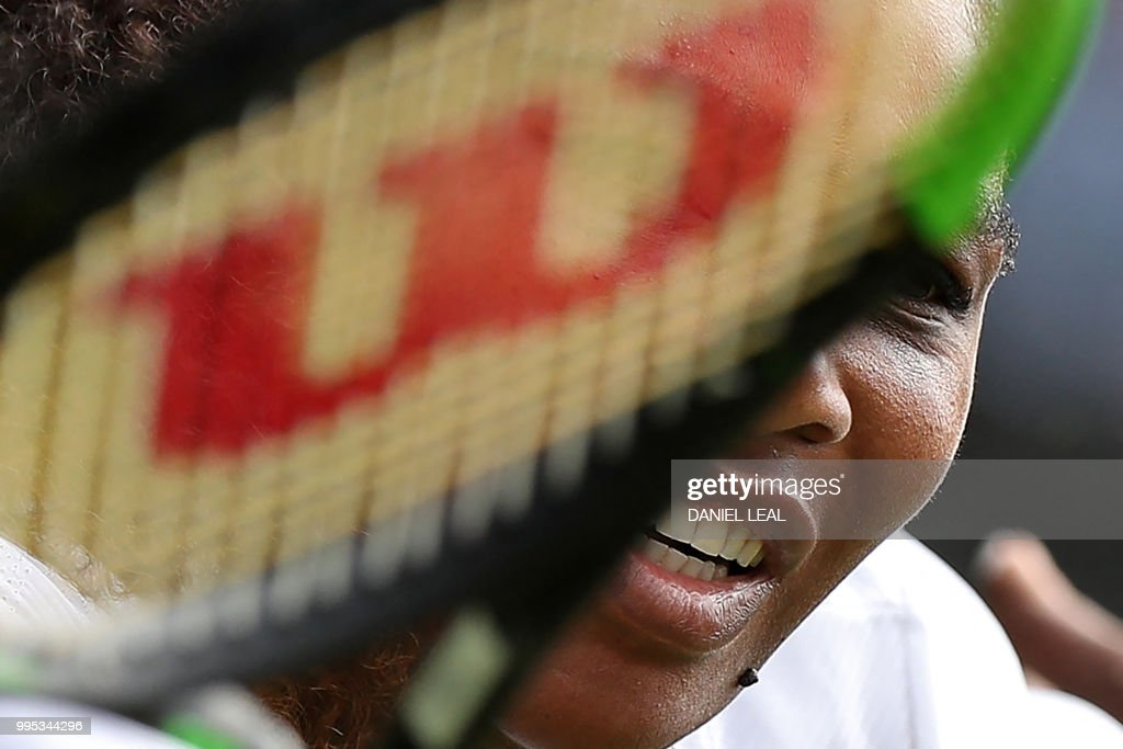 TOPSHOT - US player Serena Williams returns against Italy's Camila Giorgi during their women's singles quarter-final match on the eighth day of the 2018 Wimbledon Championships at The All England Lawn Tennis Club in Wimbledon, southwest London, on July 10, 2018. (Photo by Daniel LEAL-OLIVAS / AFP) / RESTRICTED