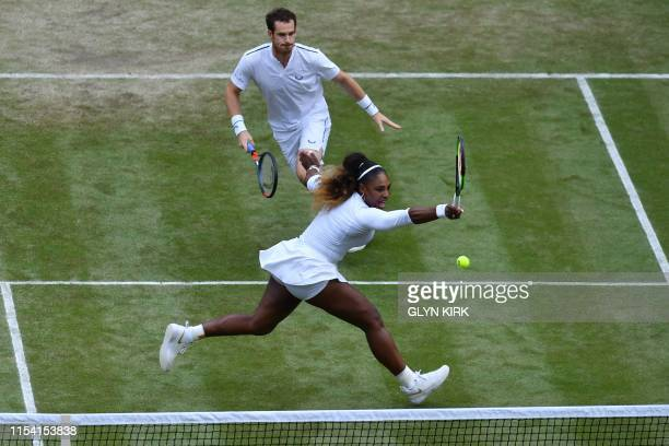 US player Serena Williams returns as her partner Britain's Andy Murray covers against Germany's Andreas Mies and Chile's Alexa Guarachi during their...