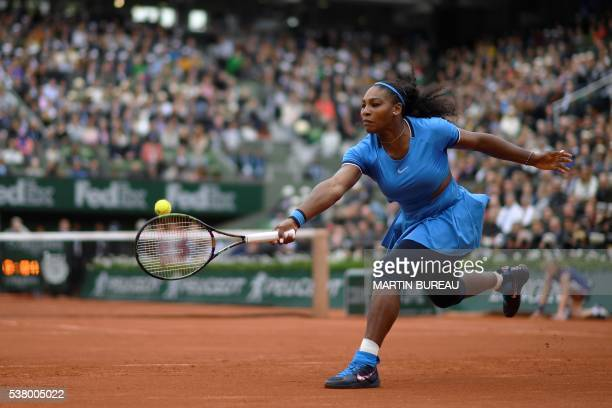 TOPSHOT US player Serena Williams returns the ball to Spain's Garbine Muguruza during their women's final match at the Roland Garros 2016 French...