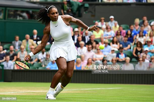 TOPSHOT US player Serena Williams returns to Russia's Svetlana Kuznetsova during their women's singles fourth round match on the eighth day of the...