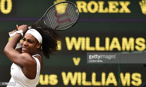 Player Serena Williams returns to US player Venus Williams during their women's singles fourth round match on day seven of the 2015 Wimbledon...