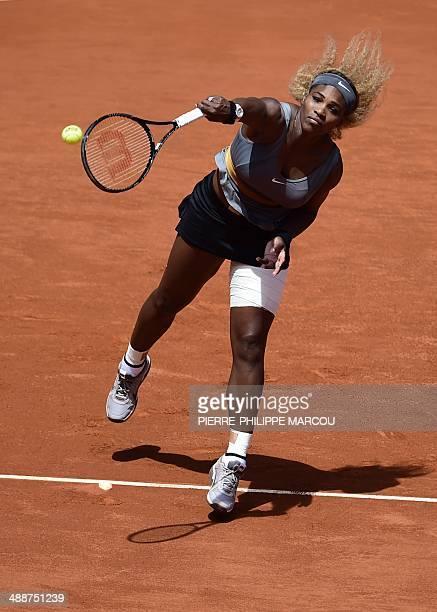 US player Serena Williams serves against Spanish player Carla Suarez Navarro during their women's singles third round tennis match of the Madrid...