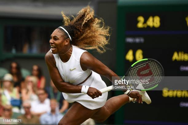 Player Serena Williams serves against US player Alison Riske during their women's singles quarter-final match on day eight of the 2019 Wimbledon...