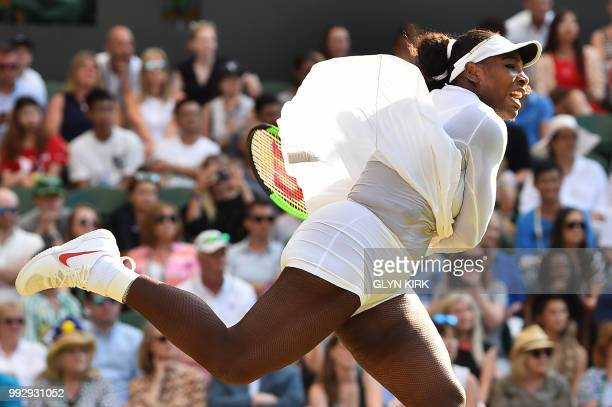 TOPSHOT US player Serena Williams serves to France's Kristina Mladenovic in their women's singles third round match on the fifth day of the 2018...