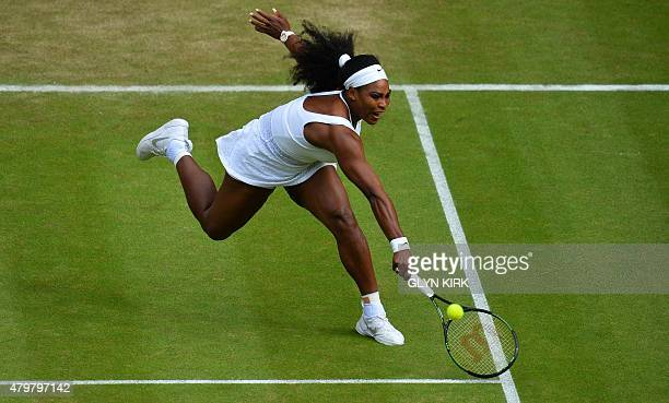 US player Serena Williams stretches to return the ball to Belarus's Victoria Azarenka during their women's quarterfinals match on day eight of the...