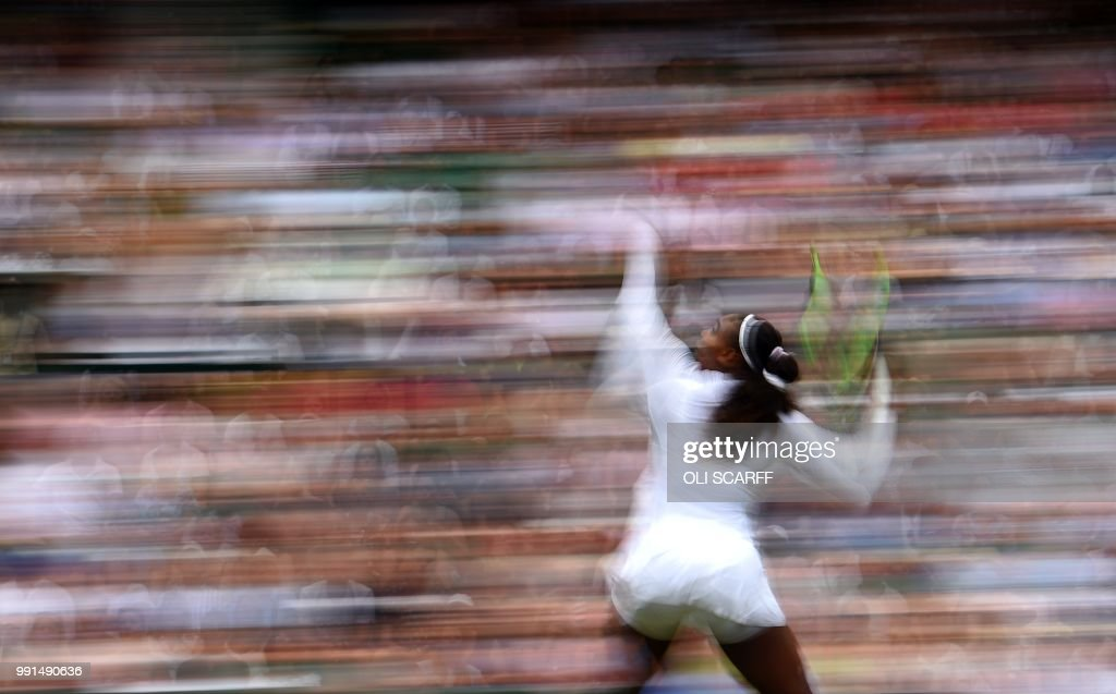 TOPSHOT - US player Serena Williams throws the ball to serve against Bulgaria's Viktoriya during their women's singles second round match on the third day of the 2018 Wimbledon Championships at The All England Lawn Tennis Club in Wimbledon, southwest London, on July 4, 2018. (Photo by Oli SCARFF / AFP) / RESTRICTED