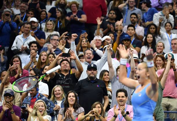 Player Shelby Rogers throws her racquet as she celebrates her win over Australia's Ashleigh Barty during their 2021 US Open Tennis tournament women's...
