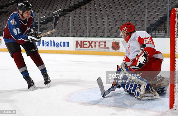 A player shoots the puck past the glove hand of the goalie during the NHL Concept Shoot on February 22 2003 at the American Airlines Center in Dallas...