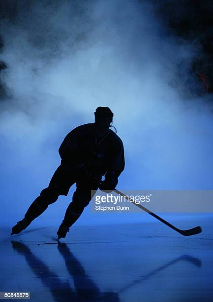 A player skates through the smoke during introductions prior to game one of the Western Conference quarterfinal series of the 2004 Stanley Cup...