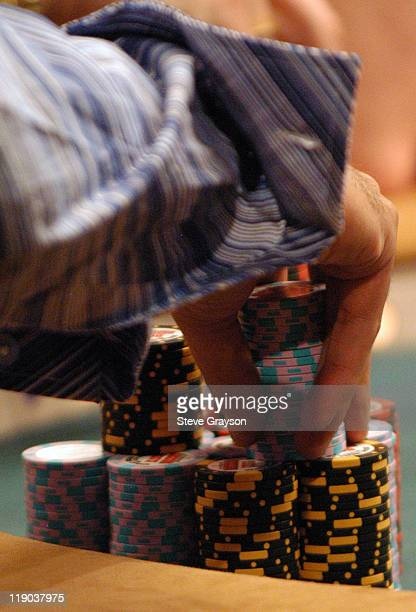A player stacks his winnings during day six of the 2004 World Series of Poker at Binion's Horseshoe Club and Casino in Las Vegas Nevada May 27 2004