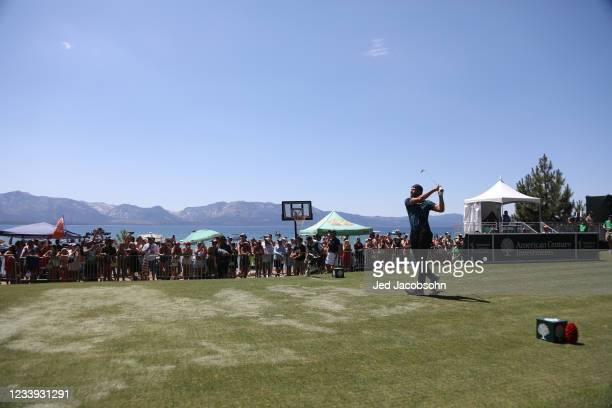 Player Steph Curry tees off on the 17th hole during the final round of the American Century Championship at Edgewood Tahoe South golf course on July...