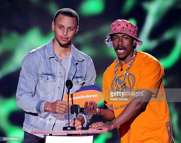 NBA player Stephen Curry and TV personality Nick Cannon speak onstage during Nickelodeon Kids' Choice Sports Awards 2014 at UCLA's Pauley Pavilion on...