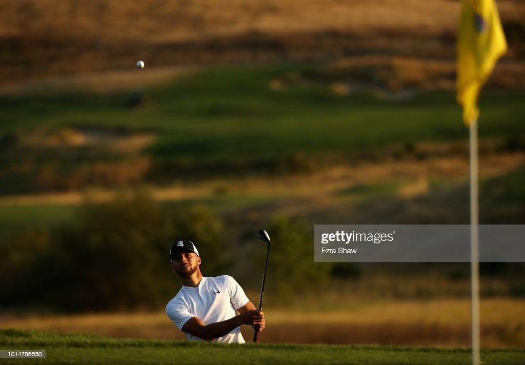 NBA player Stephen Curry of the Golden State Warriors chips on to the green on the 16th hole during Round Two of the Ellie Mae Classic at TBC Stonebrae on August 10, 2018 in Hayward, California.