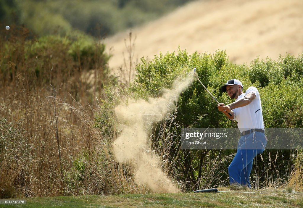 NBA player Stephen Curry of the Golden State Warriors hits out of the rough on the seventh hole during Round Two of the Ellie Mae Classic at TBC Stonebrae on August 10, 2018 in Hayward, California.