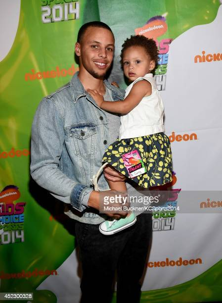 NBA player Stephen Curry with daughter Riley Curry backstage at the Nickelodeon Kids' Choice Sports Awards 2014 at UCLA's Pauley Pavilion on July 17...