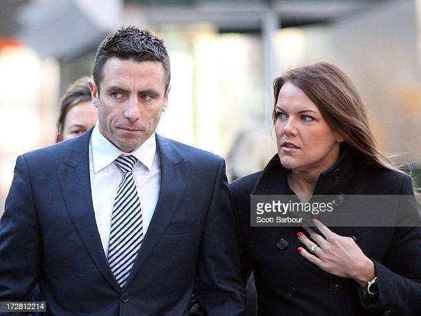 AFL player Stephen Milne of the St Kilda Saints and his wife Melissa Rudling arrive at Melbourne Magistrates Court on July 5 2013 in Melbourne...