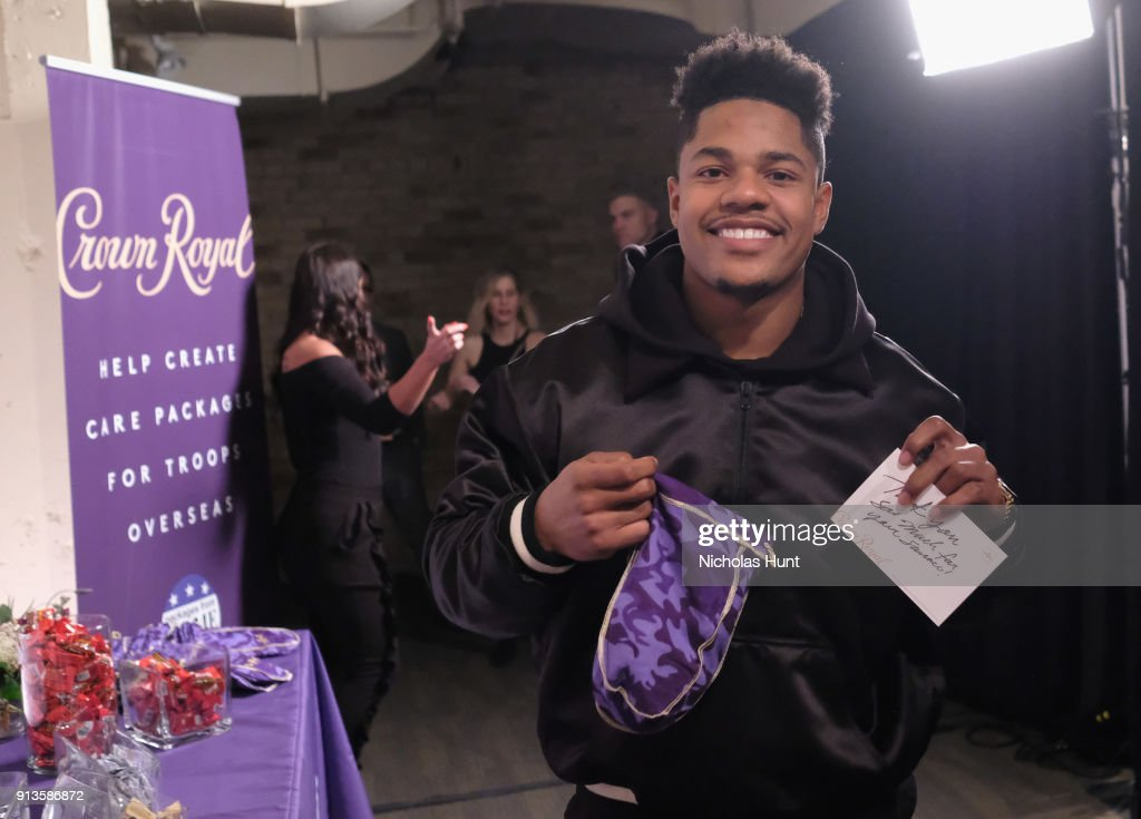 NFL player Sterling Shepard packs a Crown Royal care package during the Rolling Stone Live party on February 2, 2018 in Minneapolis, Minnesota.