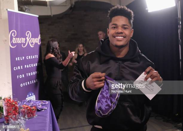 NFL player Sterling Shepard packs a Crown Royal care package during the Rolling Stone Live party on February 2 2018 in Minneapolis Minnesota