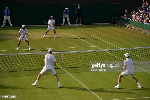 US player Steve Johnson and his partner US player Sam Querrey play against US players Bob Bryan and Mike Bryan during their men's doubles second...