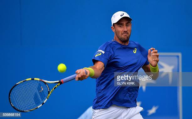 US player Steve Johnson plays a forehand during his men's singles match against France's Richard Gasquet at the ATP tournament at Queen's tennis club...